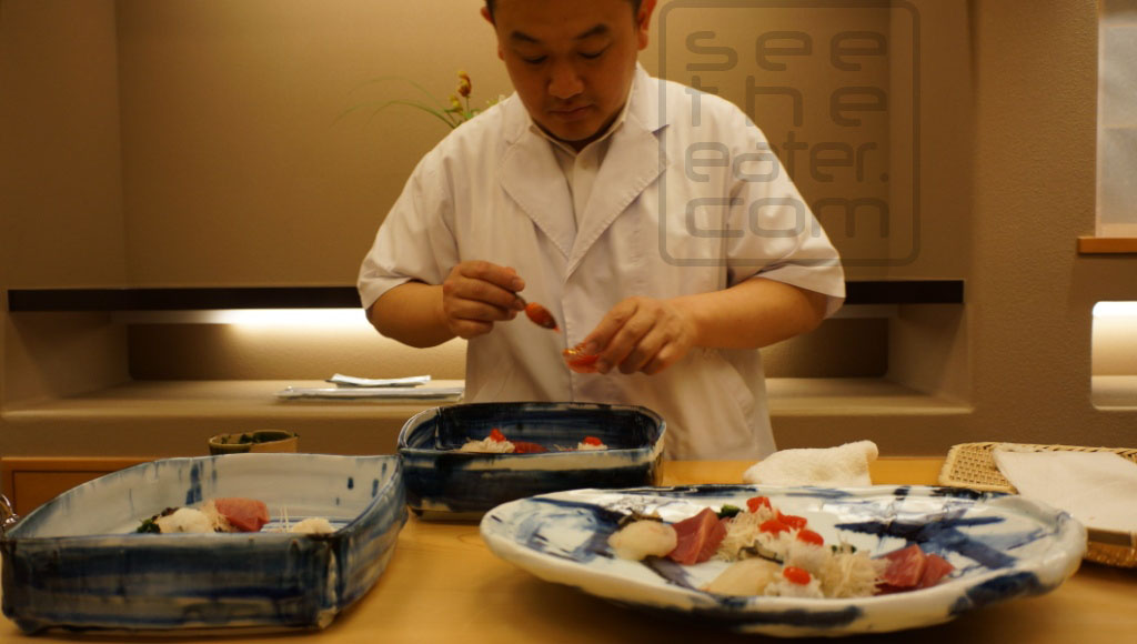 Chef Toru Okuda preparing sashimi