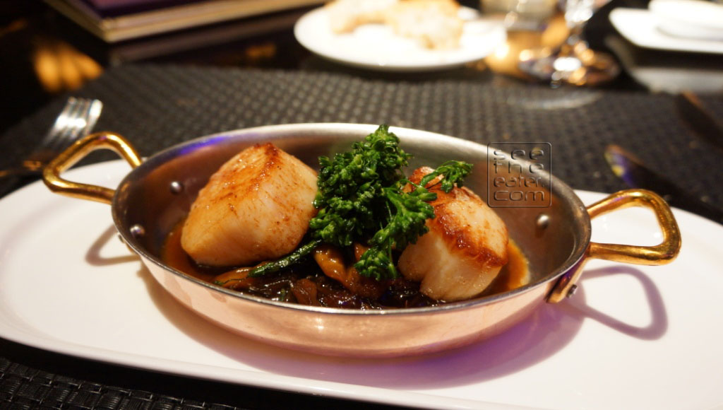 MAINE DAYBOAT SCALLOPS Braised Oxtai l/Wild Mushrooms Salted Caramel Reduction