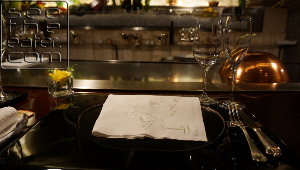 Table setting. Napkin with their restaurant's design sewn on